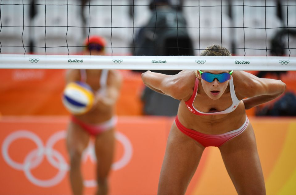 Canada's Sarah Pavan waits for her teammate to serve the ball during the women's beach volleyball qualifying match between Canada and the Netherlands at the Beach Volley Arena in Rio de Janeiro on August 7, 2016, for the Rio 2016 Olympic Games. / AFP PHOTO / Leon NEALLEON NEAL/AFP/Getty Images
